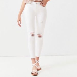 White Mid Rise Skinniest Ankle Jeans